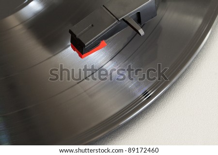 Closeup of needle over a wheeling record on a turntable - stock photo