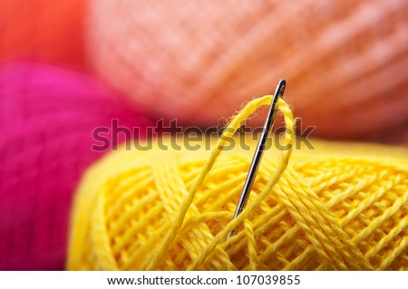 closeup of needle with yarn thread background - stock photo