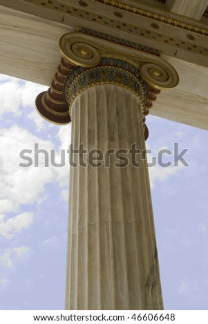 Closeup of neoclassical ionic column in Academy of Athens, Greece.