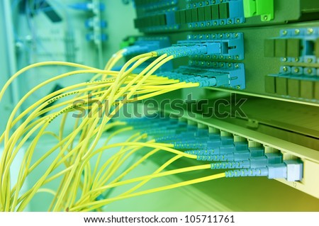 closeup of network hub and cables - stock photo
