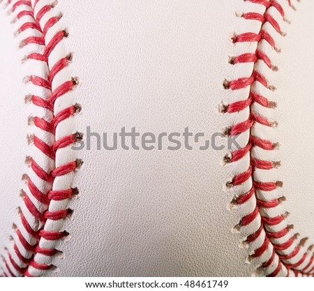 Closeup of new baseball with red stitches - stock photo