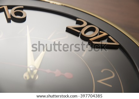 closeup of new year 2017 lie on clock face - dial. the end of 2016. Happy holiday time. - stock photo