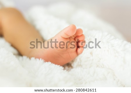 Closeup of newborn baby - stock photo
