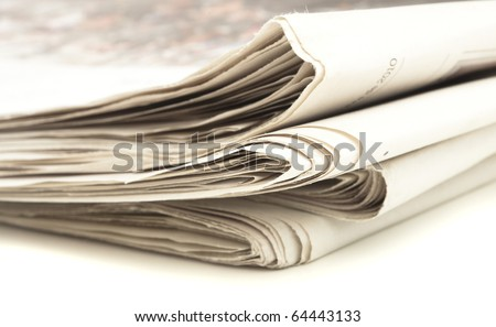closeup of newspaper on a white background - stock photo