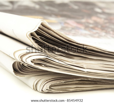 closeup of newspaper on a white background