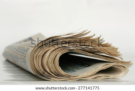 Closeup of newspapers on light background. Shallow depth of field. - stock photo