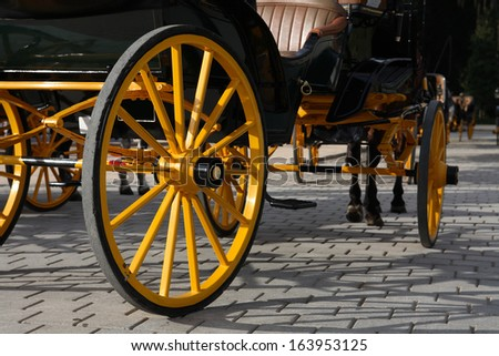 Closeup of nice vintage coach with big yellow wheel - stock photo