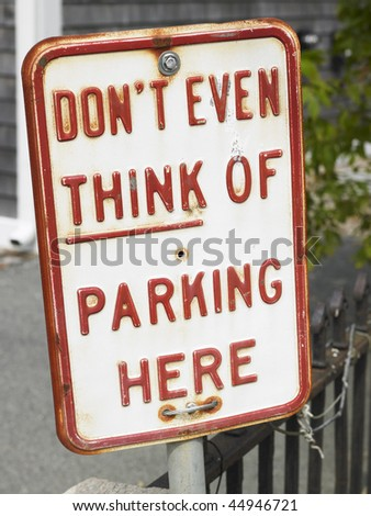 Closeup of no parking sign. Vertical shot. - stock photo