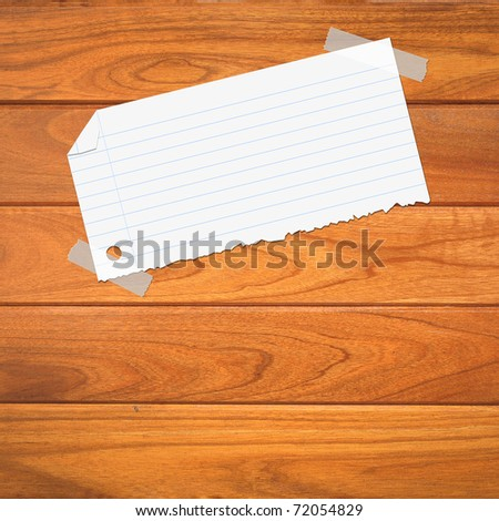 closeup of note paper on wooden background - stock photo