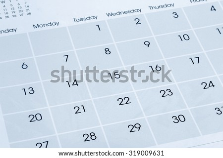 Closeup of numbers on calendar page - stock photo