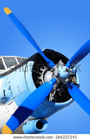 Closeup of old airplane engine with propeller against blue sky. Isolated with clipping path - stock photo