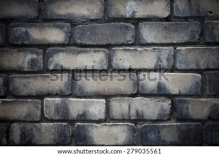 Closeup of old brick wall. Lens vignetting applied.  - stock photo