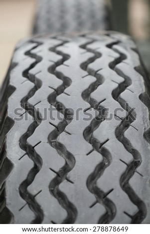 Closeup of old cracked tire texture - stock photo