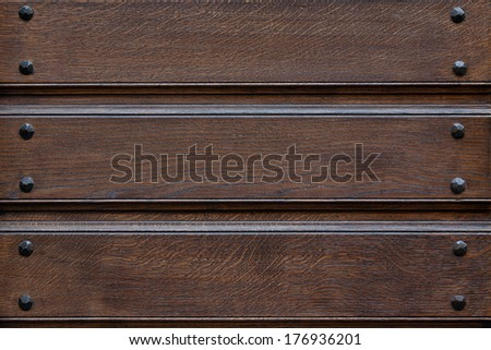 Closeup of old dirty wooden door structure pattern with iron nails - stock photo