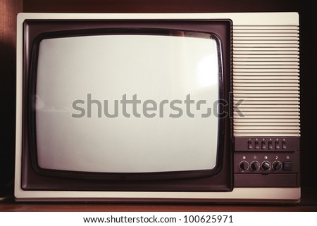 Closeup of old dusty TV set - stock photo