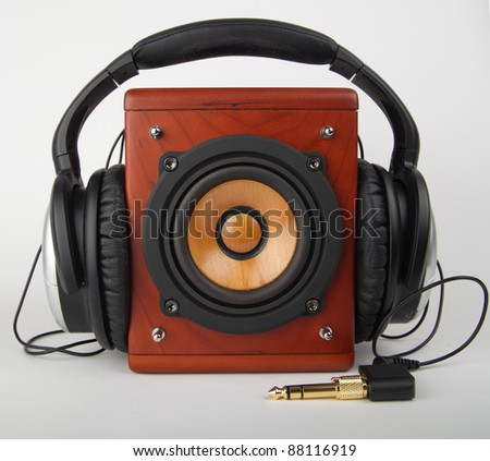 Closeup of old loudspeaker and headset - stock photo