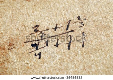 Closeup of old math problem - stock photo