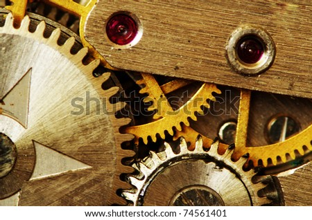 Closeup of old metal clock mechanism - stock photo