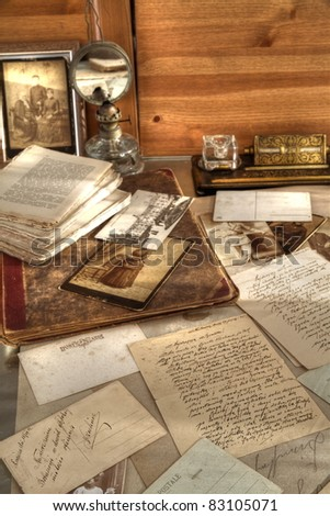 Closeup of old photos,books and correspondence. - stock photo