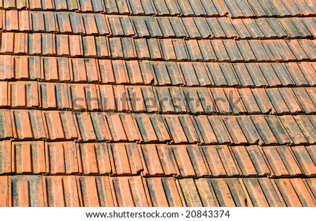 Closeup of old red roof tiles