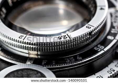 Closeup of old retro film camera lens - stock photo