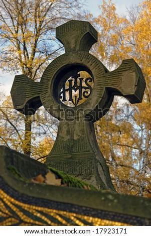 Closeup of old tombstone cross - stock photo
