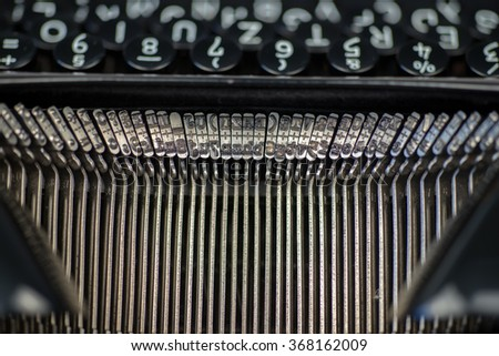 Closeup of old typewriter letter and symbol keys