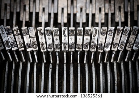 closeup of old typewriter letters - stock photo