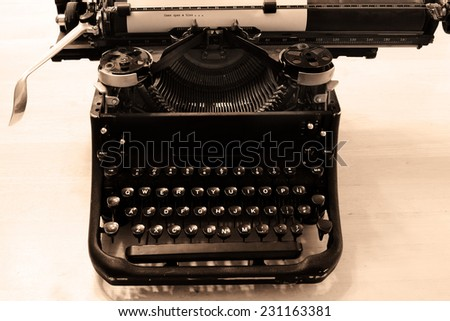 Closeup of old typewriter letters and keys for typing on documents business - stock photo