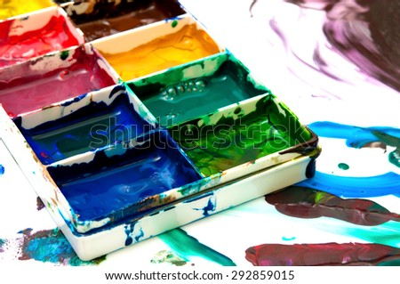 closeup of old used paintbox - stock photo