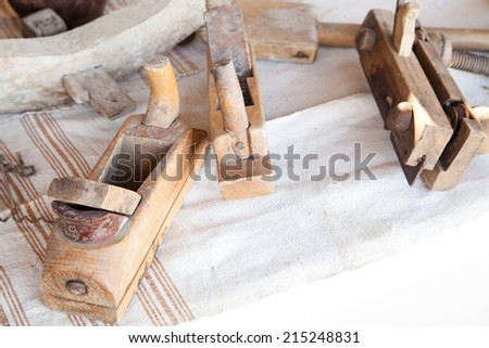 Closeup of old wooden carpentry planers with selective focus - stock photo
