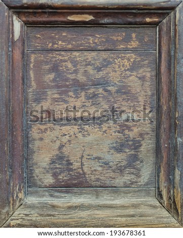 Closeup of old wooden texture background with peeling paint and frame. For vintage branding and hipster logo. - stock photo