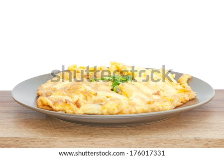closeup of omelette, typical rolled plain omelette on a white background - stock photo