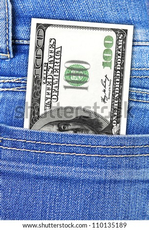 closeup of one hundred dollars in jeans pocket