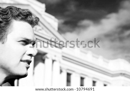 Closeup of one man with collar shirt in front of courthouse and sky - stock photo