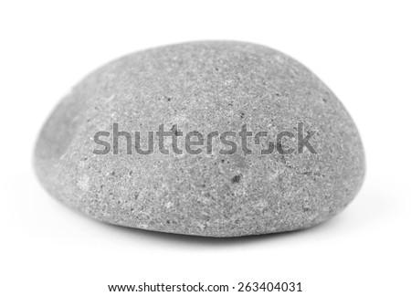 Closeup of one rock on plain background - stock photo