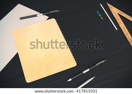 Closeup of open notepad with black and beige pages placed on dark desktop with other office tools. Mock up, 3D Rendering - stock photo