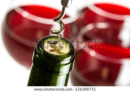 Closeup of opening wine bottle on white background - stock photo