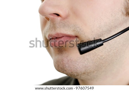 Closeup of operator's mouth with microphone. Isolated on white. - stock photo