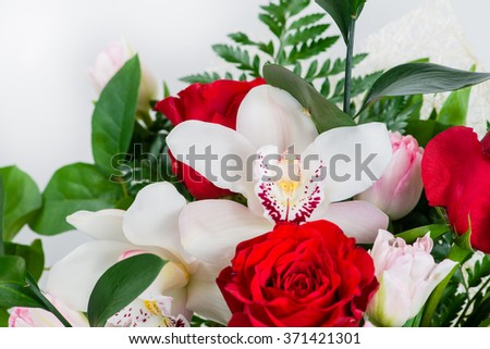 closeup of orchid flowers in the bouquet (shallow DOF) - stock photo