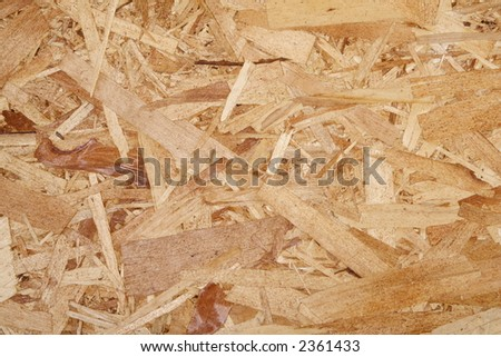 Closeup of oriented strand board OSB, construction material made of recycled wood