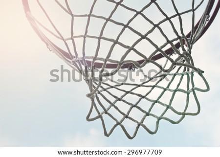 closeup of outdoor basketball hoop net - stock photo