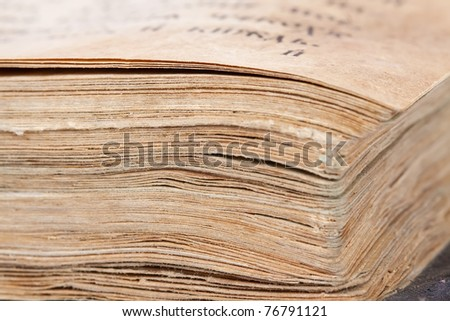 Closeup of pages of ancient book. Shallow DOF - stock photo