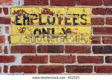 Closeup of painted sign on brick wall wall. - stock photo