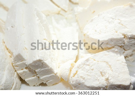 Closeup of paneer cut into pieces on buttercloth - stock photo