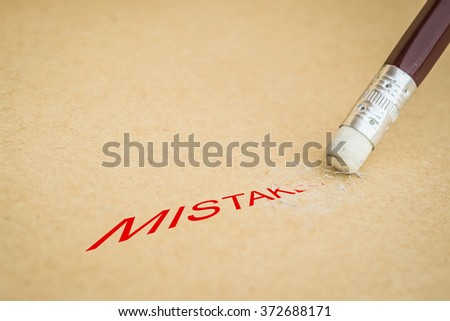 Closeup of pencil eraser and the word MISTAKES, soft focus - stock photo
