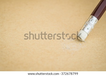 Closeup of pencil eraser on recycle paper, soft focus - stock photo