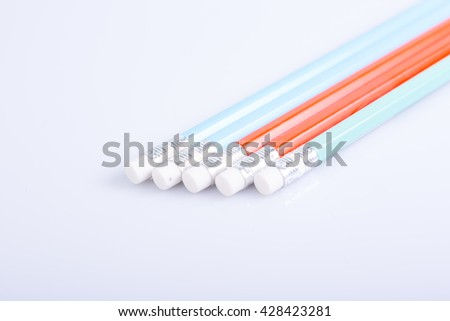 Closeup of pencil eraser on white background - stock photo