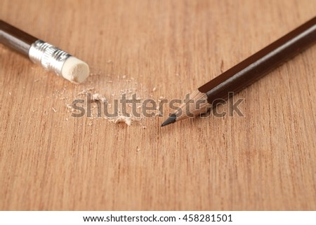Closeup of pencil eraser on wooden table - stock photo