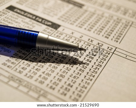 Closeup of pencil on a betting wager's list. - stock photo